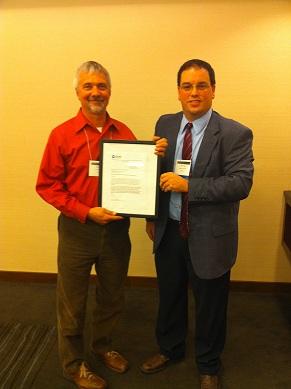 Jeff Volpe presents achievement award to Butch Conover